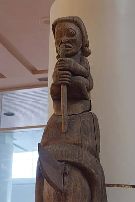 Photograph - Carved Totem Pole by Devinder Sangha