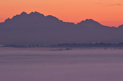 Pucker Up - Cascade Mountain Range with fog in valley by Jim Corwin