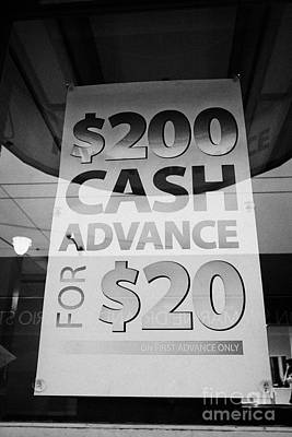 Lender Photograph - cash advance dollars sign in loan store window Vancouver BC Canada by Joe Fox