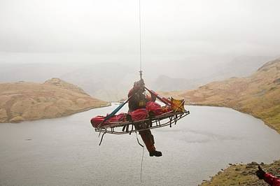 Helicopter Photograph - Casualty Winched Into Sea King Helicopter by Ashley Cooper