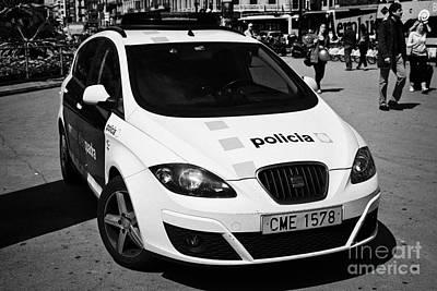 Patrol Cars Photograph - catalonian police force mossos d'esquadra patrol car in placa catalunya Barcelona Catalonia Spain by Joe Fox