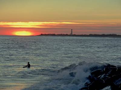 Photograph - Catching A Wave At Sunset by Ed Sweeney