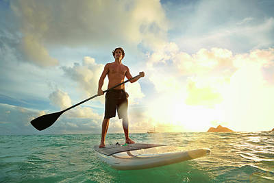 Caucasian Man On Paddle Board In Water Art Print by Colin Anderson Productions Pty Ltd