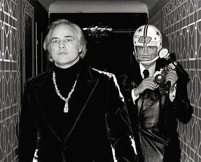 Rowing Royalty Free Images - Celebrity stalker paparazzi photographer Ron Galella and Marlon Brando 1973-2014 Royalty-Free Image by David Lee Guss