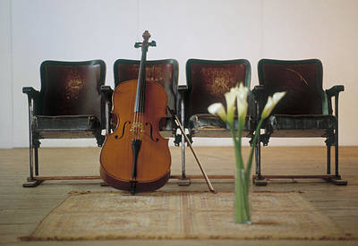 Focus On Background Photograph - Cello Leaning On Attached Chairs by Panoramic Images