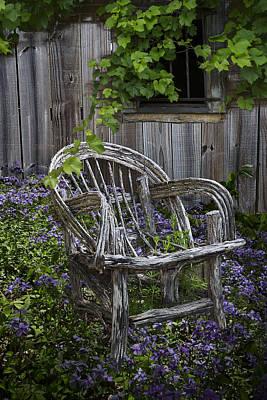Chair In The Garden Art Print by Debra and Dave Vanderlaan