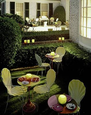 Morrison Photograph - Chairs And Tables In A Garden by Ernst Beadle