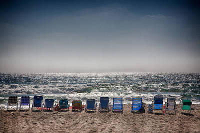 Beach Royalty-Free and Rights-Managed Images - Chairs watching the sunset by Peter Tellone