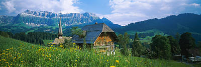 Residential Structure Photograph - Chalet And A Church On A Landscape by Panoramic Images