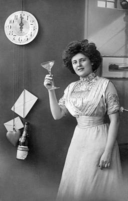 Champagne Glasses Photograph - Champagne Toast At Midnight by Underwood Archives