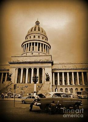 Changing A Tire In Front Of The Capitol Building In Havana Print by John Malone