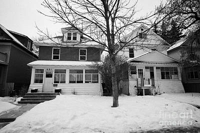 character homes during winter in caswell hill Saskatoon Saskatchewan Canada Print by Joe Fox