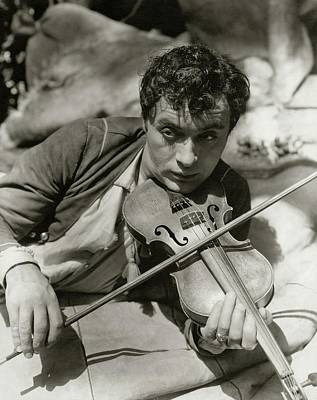 Photograph - Charles Boyer Playing A Violin by George Hoyningen-Huene