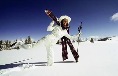 Winter Sky Photograph - Charlotte Rampling Wearing White Ski Wear by Arnaud de Rosnay
