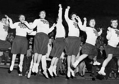 High School Sports Photograph - Cheerleaders Jump For Joy by Underwood Archives