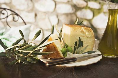 Cheese, Green Olives And Olive Oil On Table Out Of Doors Art Print