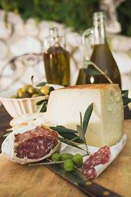 Cheese, Salami, Olives And Olive Oil On Table Out Of Doors Art Print