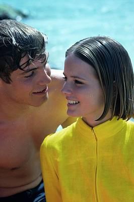 Cheryl Tiegs With A Male Model On A Beach Art Print