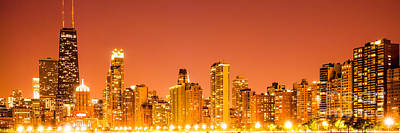 Chicago Skyline At Night Panoramic Photo In Orange Print by Paul Velgos