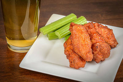 Beer Royalty-Free and Rights-Managed Images - Chicken Buffalo Wings with Celery Sticks and Beer by Brandon Bourdages