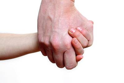 Two People Holding Hands Photograph - Child And Adult Holding Hands by Victor De Schwanberg