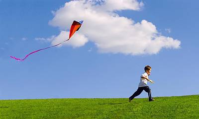 Kite Flying Photograph - Child Flying A Kite by Don Hammond