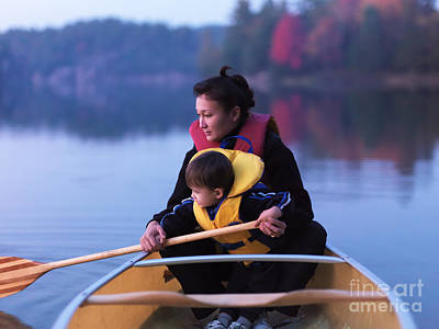 Fall Photograph - Child Learning To Paddle Canoe by Oleksiy Maksymenko