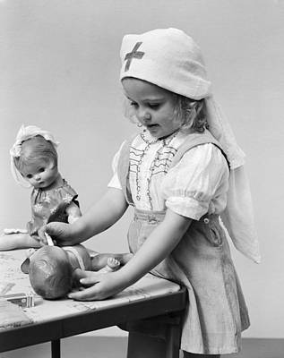 Child Playing Doctor With Dolls, C.1940s Print by H. Armstrong Roberts/ClassicStock