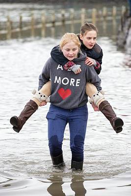 Floods Photograph - Children Wade Through Flood Waters by Ashley Cooper
