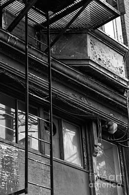 Photograph - Chinatown Fire Escape Ladder by John Rizzuto