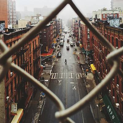 Chinatown Seen Through Fence On A Foggy Art Print by Alexander Spatari