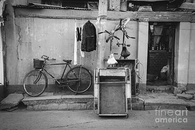 Chinese Still Life With Bicycles And Laundry Art Print by Dean Harte