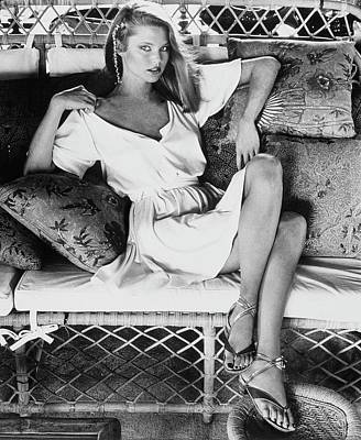 Cross Legged Photograph - Christie Brinkley Wearing A Callaghan Dress by Kourken Pakchanian