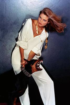 Doberman Pinscher Photograph - Christie Brinkley Wearing Geoffrey Beene Pajamas by Chris Von Wangenheim