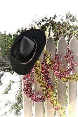 Christmas Cowboy Hat On A Fence Art Print by Olivier Le Queinec