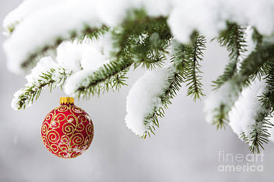 Christmas Ornament In The Snow Print by Diane Diederich
