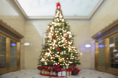 Mountain Landscape Rights Managed Images - Christmas Tree with Decorations and Wrapped Gifts Bokeh Royalty-Free Image by Jit Lim