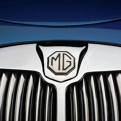 Part Of Photograph - Chrome Radiator Grill And Badge Of Blue by Panoramic Images