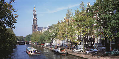 Paddle Boat Photograph - Church Along A Channel In Amsterdam by Panoramic Images
