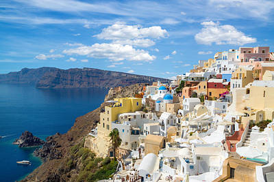 Photograph - Churches Of Oia Village Under Puffy Clouds by Gurgen Bakhshetsyan