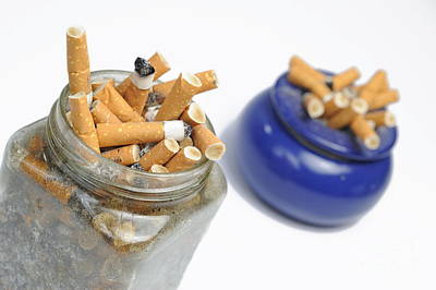 Photograph - Cigarettes Butts In Jar And Ashtray by Sami Sarkis