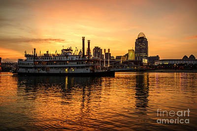 Riverboat Photograph - Cincinnati Skyline And Riverboat At Sunset by Paul Velgos