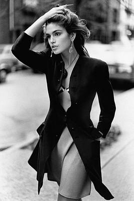Look Away Photograph - Cindy Crawford Wearing A Wool Coat Over A Slip by Arthur Elgort