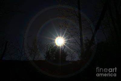 Circles Around The Sun Print by Neal Eslinger