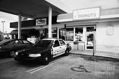City Of Florida City Police Patrol Squad Car Parked Outside Dunkin Donuts Shop Usa Art Print by Joe Fox