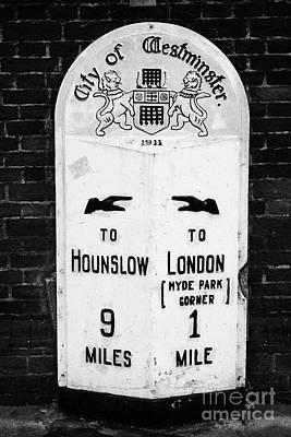 city of westminster old metal milestone between london and hounslow London England UK Print by Joe Fox