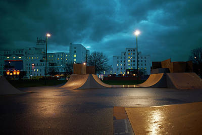 Cityscape And Skateboard Park At Night Art Print by Peter Muller