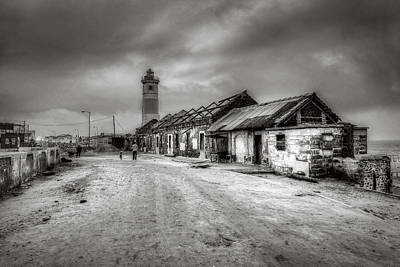 Photograph - Cityscape With Lighthouse by Roberto Pagani