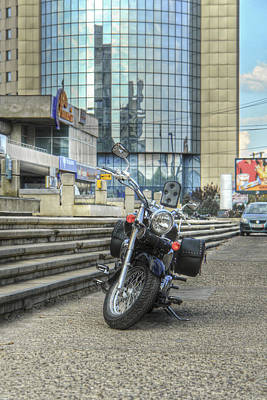 Photograph - Classic Motorcycle Parked In Front Of A Modern Glass Building by Vlad Baciu