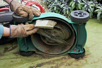 Cleaning A Lawnmower Print by Geoff Kidd